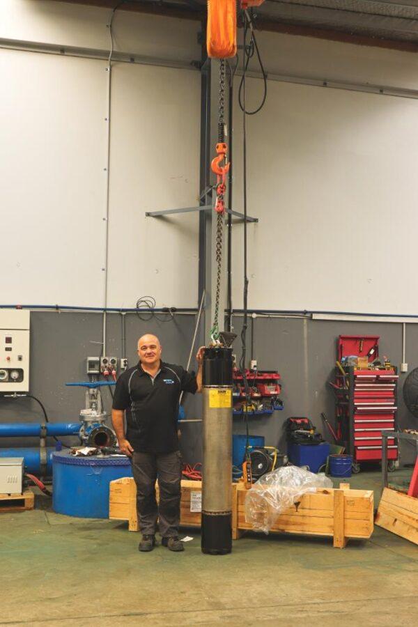Bryan holding Saer Borehole Pump